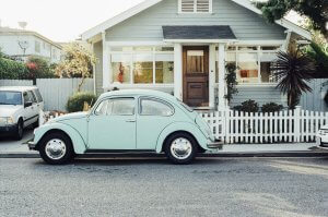 Vintage blue car in front of a house with a gate. What is an Affidavit of Heirship?