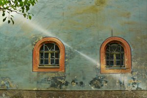 An old house with two rounded windows